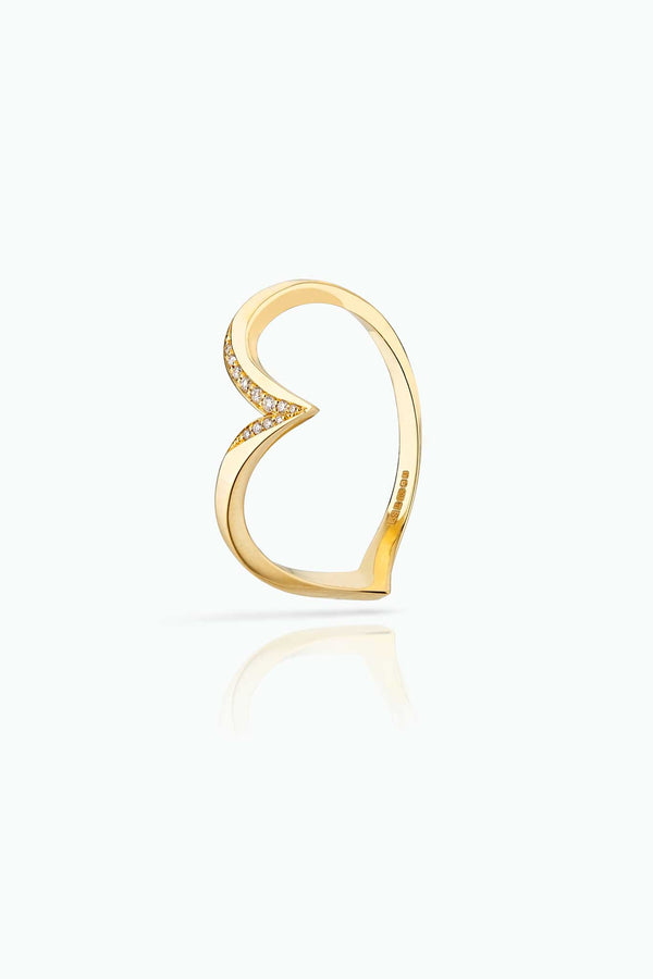 Flash Powder; 18 Carat yellow gold ring with pave set diamonds. Simple but different. Easy to Wear day-in and day-out.