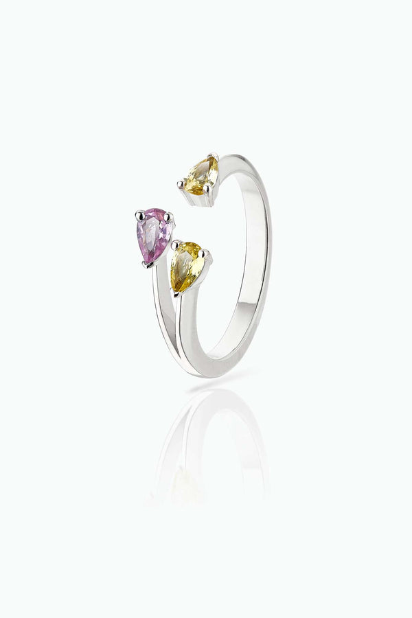 Future in Colour. 18 Carat white gold ring with pink and yellow pear sapphires. A simple design for those who enjoy colour.