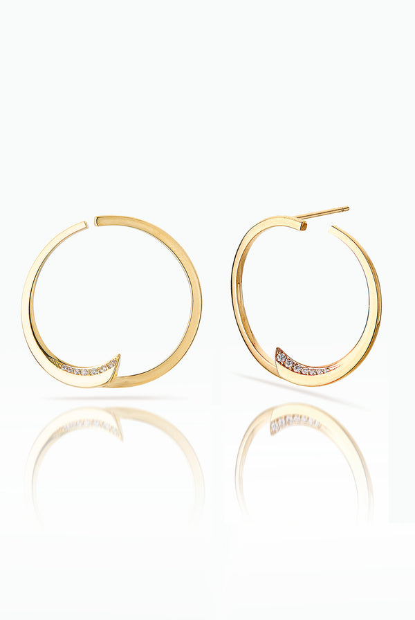 Pin Wheel. Modern hoops that play with space and line. Handcrafted in 18 Carat yellow gold with Pave Set Brilliant Diamonds, that catches the light from the side. Ideal for those who are drawn to classic pieces, but enjoy an element of surprise.  Edit alt text