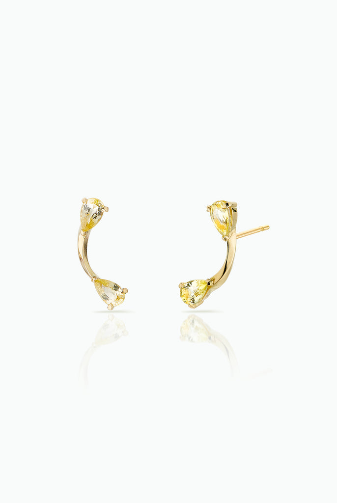 Lemon Flare Studs. Graceful flow of line, handcrafted in 18 Carat yellow gold with Yellow Pear Shaped Sapphires Ideal for those who are drawn to subtle statement and like to mix and match their earrings. Bought as a single or a pair.  Edit alt text