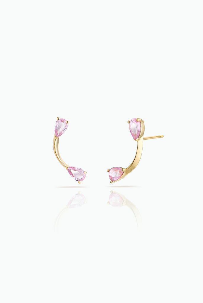 Pink Flare Studs. Graceful flow of line, handcrafted in 18 Carat yellow gold with Pink Pear Shaped Sapphires Ideal for those who are drawn to subtle statement and like to mix and match their earrings. Bought as a single or a pair.  Edit alt text