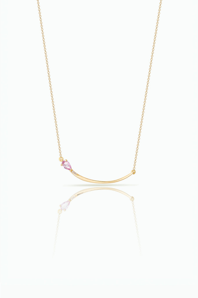 A graceful flow of line. Handcrafted in 18 Carat yellow gold with Pink Pear Shaped Sapphire and pave set diamond. Ideal for those who are drawn to subtle statements, and love detail.