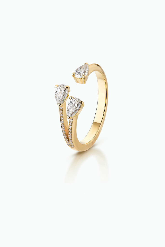 Modern 18 Carat yellow gold ring with three pear shaped diamonds, pave set on one side. A statement, day-in and day-out.