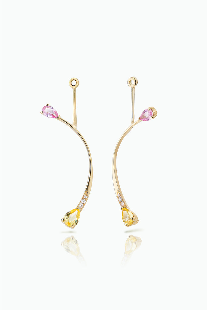 Long Rose More Jackets. Graceful flow of line, handcrafted in 18 Carat yellow gold with pear shaped Sapphire and Pave Set Brilliant Cut Diamonds. Ideal for those who like to mix and match their earrings. Bought as a single or a pair.  Edit alt text