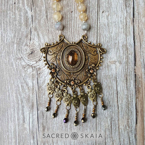 Closeup of pendant. Citrine, pyrite and labradorite are the abundance manifesting crystals also used in the Abundant Success Mala from Sacred Skaia.