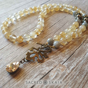 Crystals for abundance include citrine, pyrite and labradorite in the Abundant Success Half Mala from Sacred Skaia. It has 54 beads and a famous name pear-shaped crystal dangling from a bronze leaf toggle clasp.
