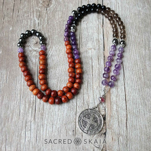 Addiction Recovery Mala by Sacred Skaia, shown as a companion to the Addiction Recovery Bracelet in custom sizes for supporting your intention to be free from addiction, made with amethyst, hematite, smoky quartz, black obsidian, lepidolite and rosewood. Includes silver accents.