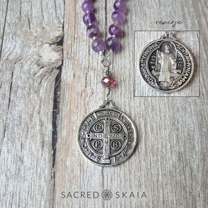 Double-sided silver pendant is a replica of St. Benedict's medal. Crystals for addiction included in the Addiction Recovery Mala are amethyst, lepidolite, smoky quartz, black obsidian, hematite and rosewood.