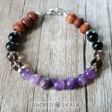 Crystal beaded bracelet in custom sizes for supporting your intention to be free from addiction, made with amethyst, hematite, smoky quartz, black obsidian, lepidolite and rosewood. Includes a silver lobster clasp and silver spacers.