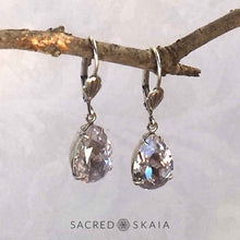 Aphrodite Crystal Teardrop Earrings with oxidized silver settings, lever back ear wires and pear-shaped smoky mauve (pale lavender gray) Swarovski crystals, shown hanging on a branch as an alternate color choice