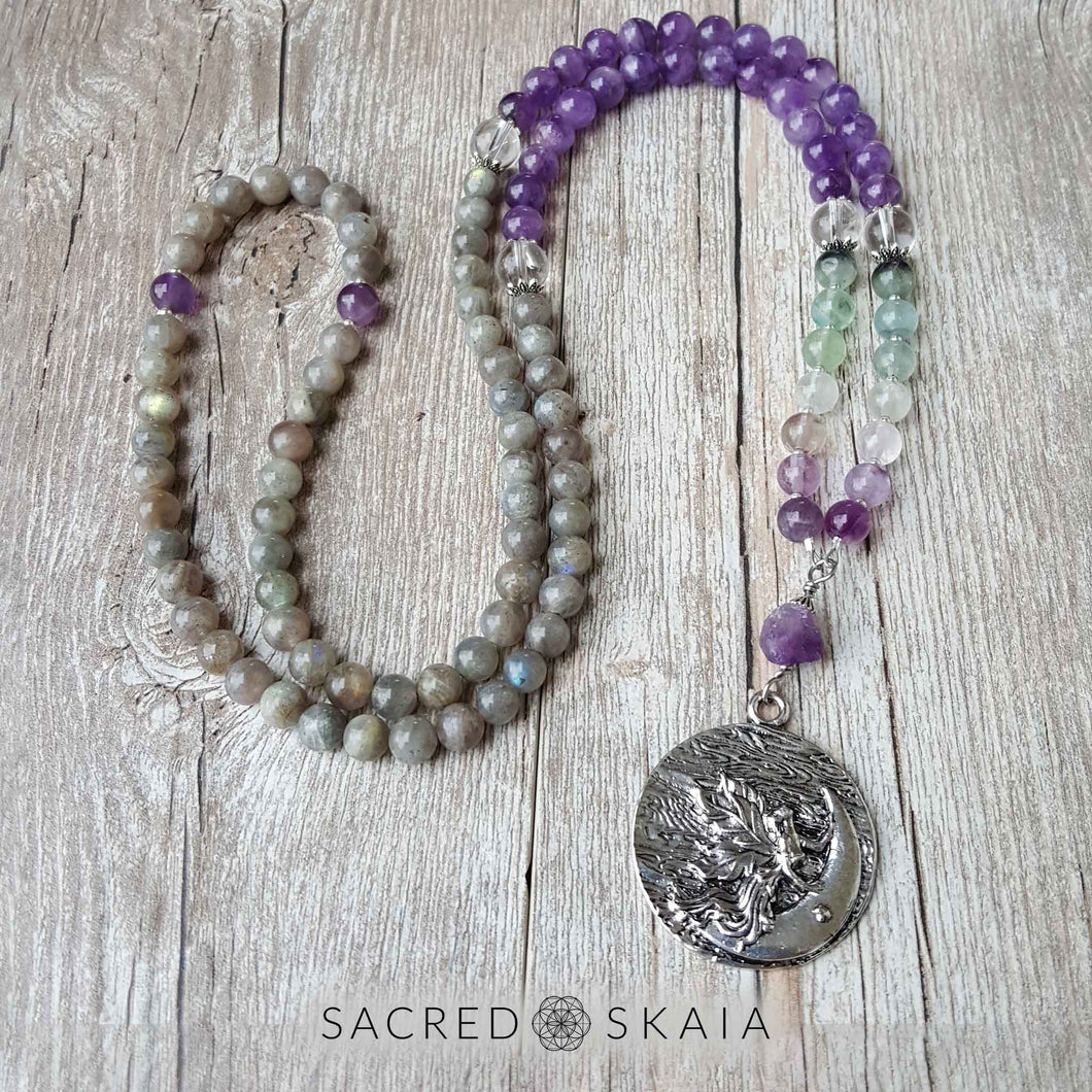 Crystals for anxiety included in the Emotional Freedom Mala by Sacred Skaia are amethyst, fluorite, clear quartz and labradorite or sandalwood. Also for use with EFT healing.