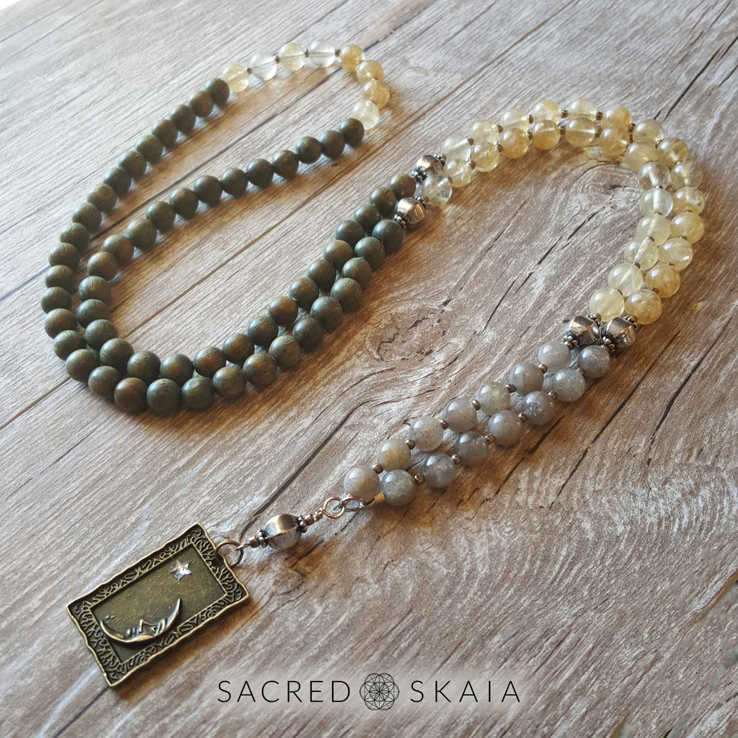 Crystals for abundance included in the Magical Abundance Mala by Sacred Skaia are citrine, labradorite, pyrite and sandalwood.