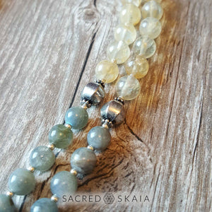 Closeup detail; Crystals for abundance included in the Magical Abundance Mala by Sacred Skaia are citrine, labradorite, pyrite and sandalwood.