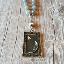 Closeup of Man in the Moon bronze pendant. Crystals for abundance included in the Magical Abundance Mala by Sacred Skaia are citrine, labradorite, pyrite and sandalwood.