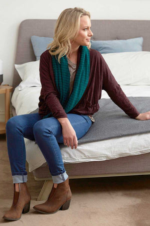 Wool short boxy cardigan in purple with Green wool scarf over Blue jeans