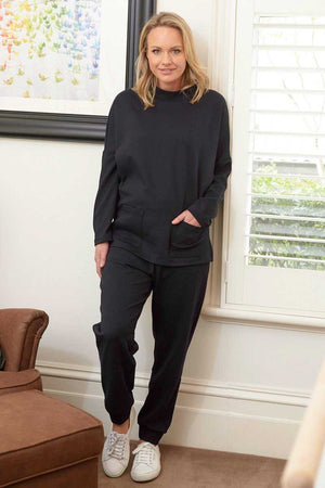 Stand neck long sleeve jumper with pockets in Navy over Navy jogger pants