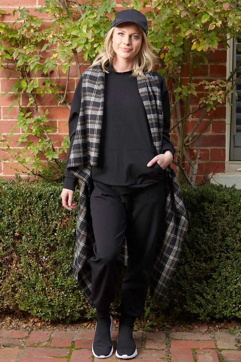 wool blend check cape with black hoodie and black jogger pants