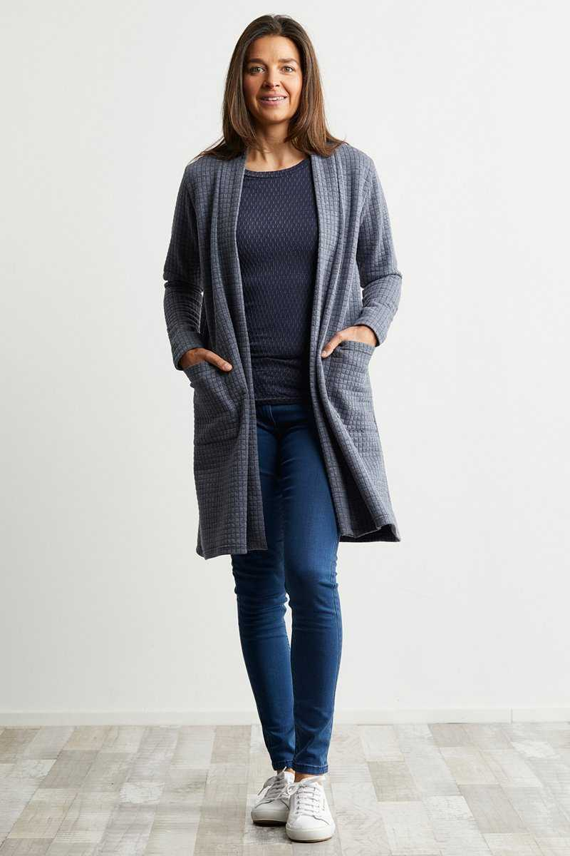 Grey cardigan with pockets over black top and black jeans
