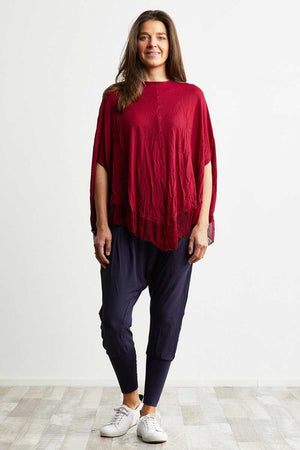 Pink poncho with mesh hem over dropped crotch viscose pant