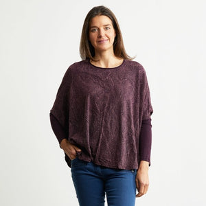 Purple soy boxy top over blue jeans