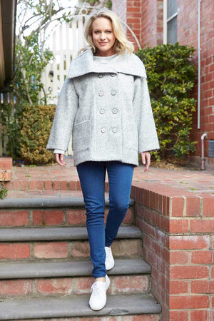 grey wool blend coat with buttons with blue jeans