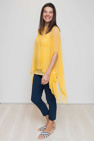 open mesh poncho in yellow over Navy cotton pants