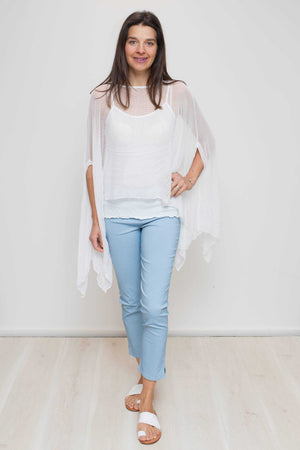 Open mesh poncho in White over light blue pants