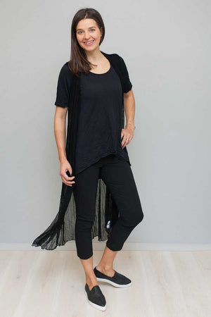 open mesh long vest in Black over black short sleeve top and Black pants