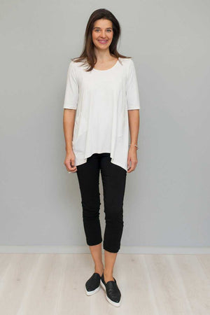 Hi-low hem top with pockets White viscose over black cotton pants