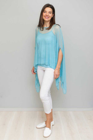 open mesh poncho in Aqua colour over White pants