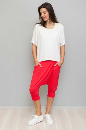 white dolman sleeve top over red viscose pant