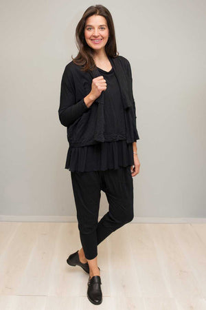 Wool short boxy cardigan in Black over Black top and dropped crotch pant