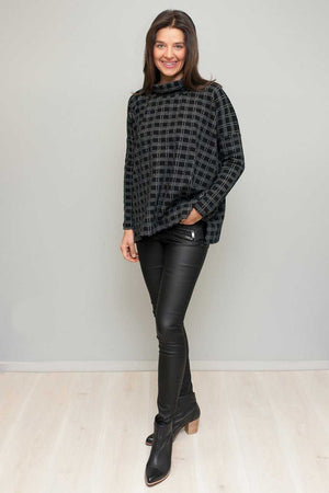 Skivvy neck boxy jumper in Black over Black shinny jeans