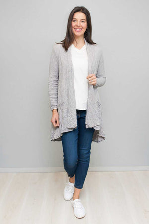 V-neck top in White Light grey cardigan over Blue jeans
