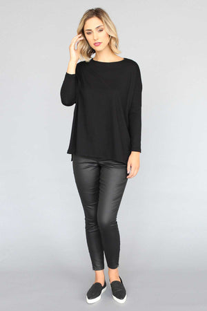 long sleeve boxy in Black over Black shinny jeans