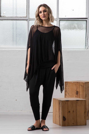 open mesh poncho in Black over dropped crotch viscose Black pants