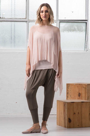 open mesh poncho in light pink over dropped crotch Khaki pant