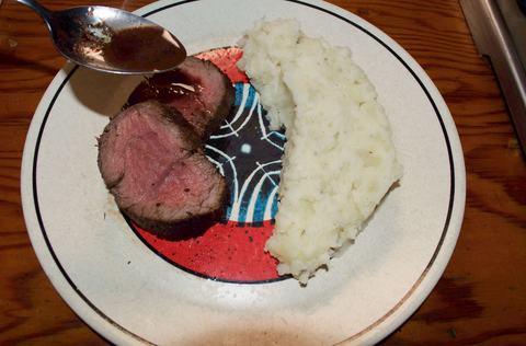 Adding wine sauce to perfectly cooked Mishima reserve Chateaubriand from online meat order
