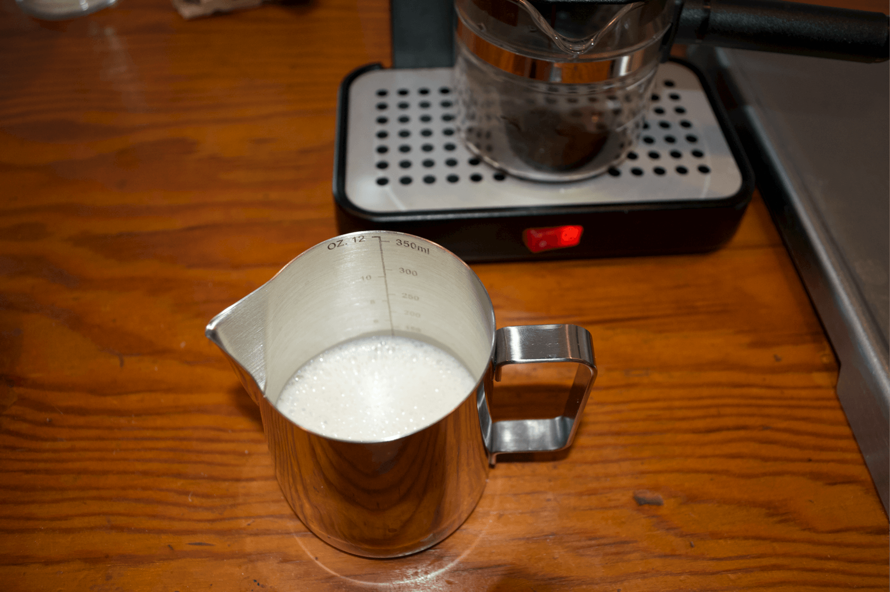 How To Make a latte with our favorite Espresso Tamper Full Set -  Getting milk ready in a metal pitcher to be frothed for our latte- Best Espresso Tamper