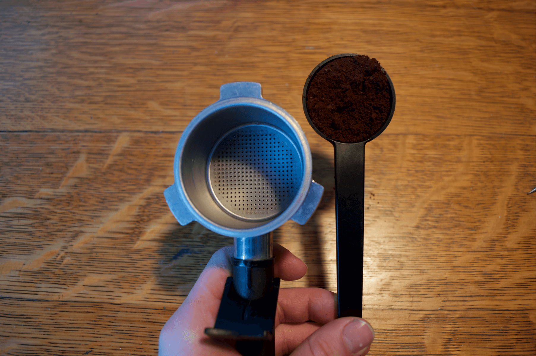 How To Make a latte with our favorite Espresso Tamper Full Set -  Ground coffee scooper filled with coffee next to empty portafilter  - Best Espresso Tamper