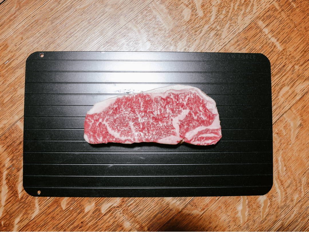 ThawTable - Defrosting Food Reimagined - What's the Best Way to Thaw Wagyu New York Strip Steaks? 12oz Wagyu NY Strip steak from W.Black Wagyu Farm via Crowd Cow sustainable meat delivery box fully thawed