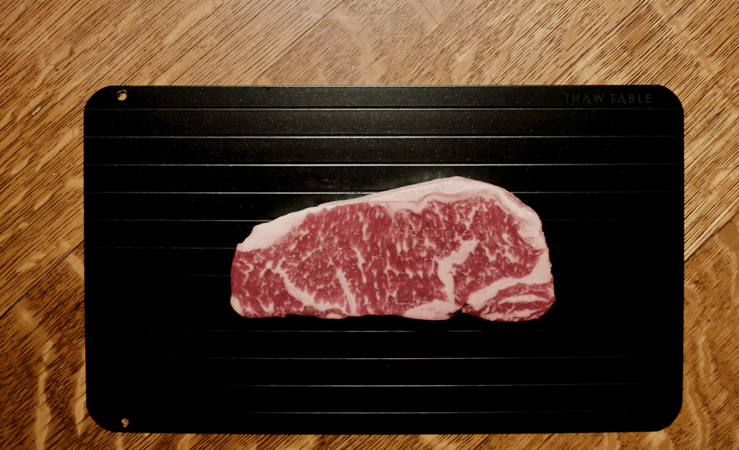 Wagyu New York Strip steak from W. Black Wagyu Farms via Crowd Cow properly defrosting on a Family Size ThawTable the best way to defrost steak