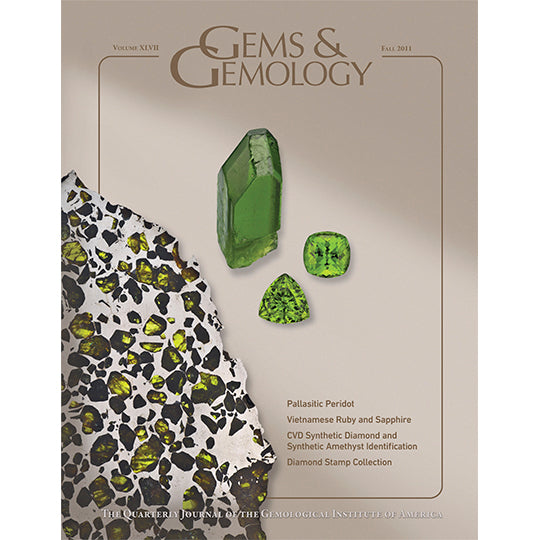 Cover of Gems & Gemology Fall 2011 issue, featuring green gems against tan background