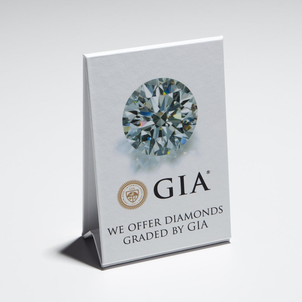 "Stand-up white cardboard display with diamond, logo, and text ""We Offer Diamonds Graded by GIA"""