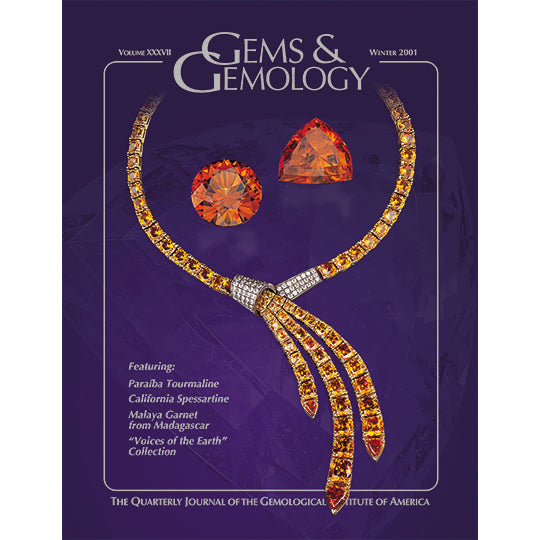 Gems & Gemology Winter 2001 issue, featuring orange gems and necklace against vibrant blue background