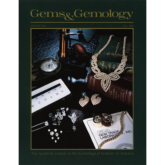 Cover of Gems & Gemology Fall 1988 issue featuring jewelry on desk with books