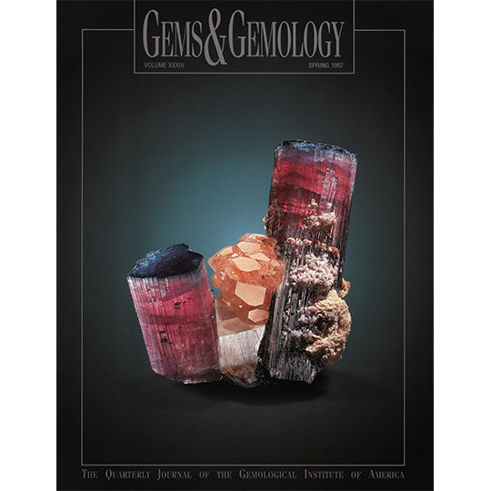 Cover of Gems & Gemology Spring 1997 issue, featuring rough gemstone shaped like 3 roughly textured cylinders
