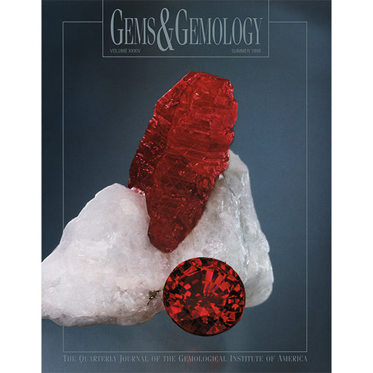 Cover of Gems & Gemology Summer 1998 issue, featuring rough red gem protruding from white stone and polished red gem