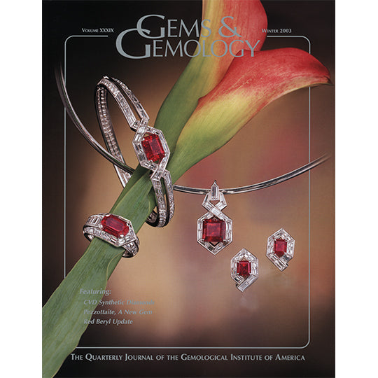 Cover of Gems & Gemology Winter 2003 issue, featuring red jewelry around birds of paradise stem