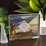 "Acrylic case on table displaying sheet with landscape imagery and text ""We offer GIA Diamond Origin"""